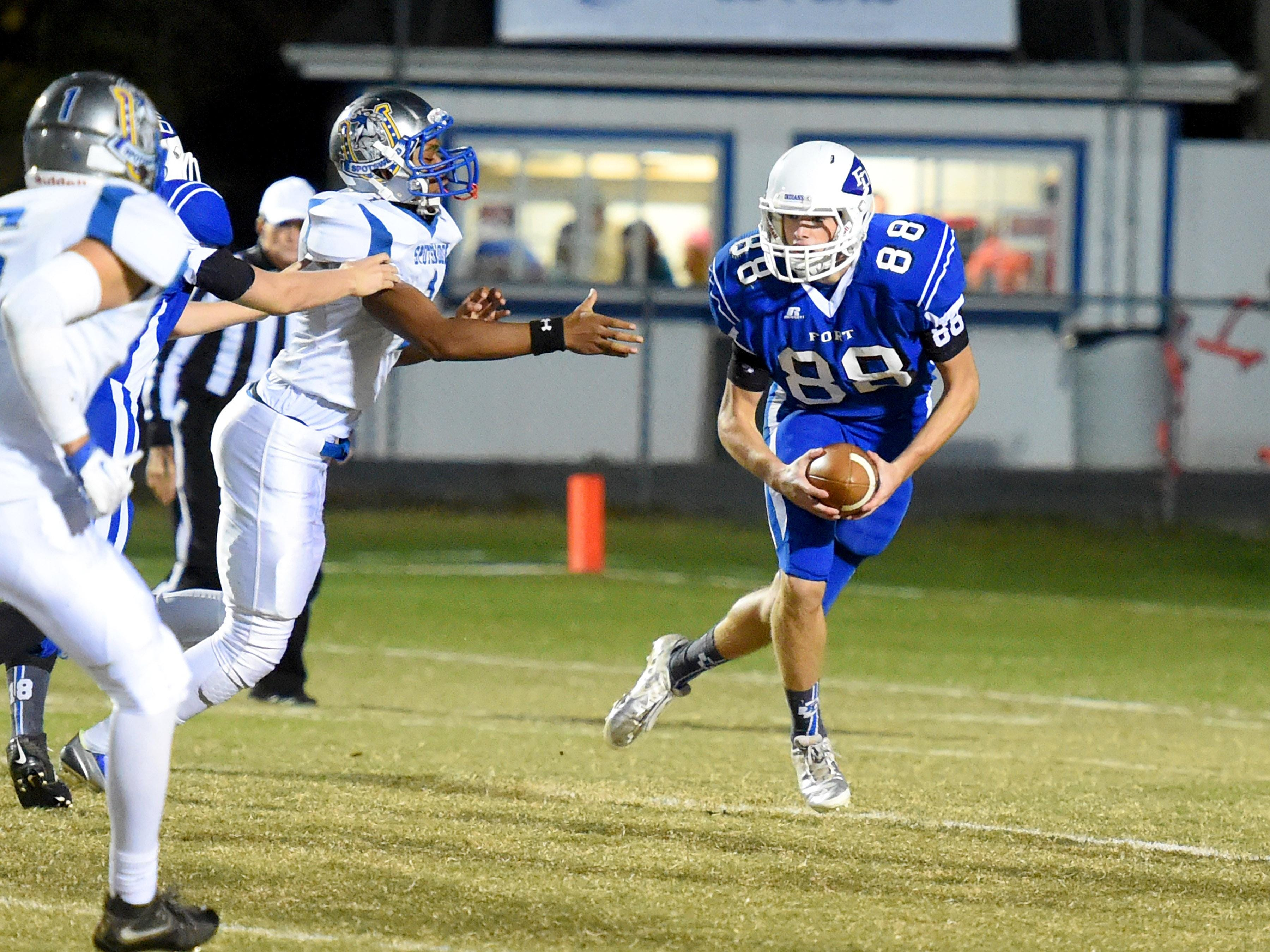 Fort Defiance's Lane McAllister cuts to the side with the ball around the Spotswood defense during their game in Fort Defiance on Friday.
