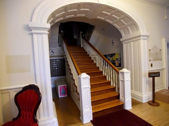 The staircase accessed from the first floor in the center of Main Hall at the Virginia School for the Deaf and the Blind was originally constructed by students decades ago.