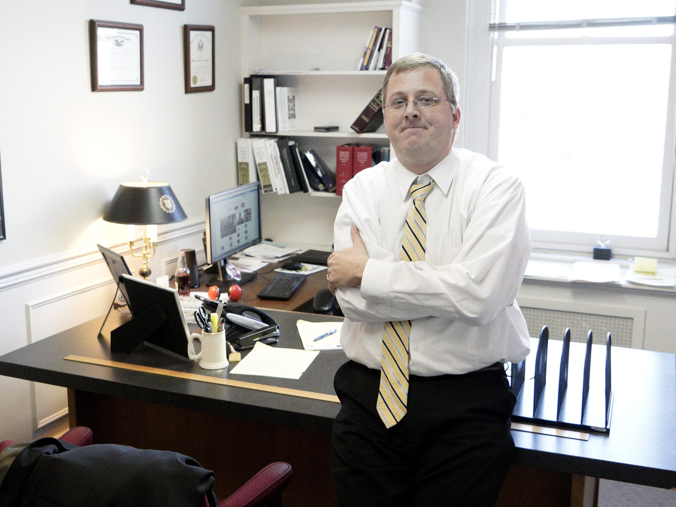 Attorney Tate Love is photographed in his office at