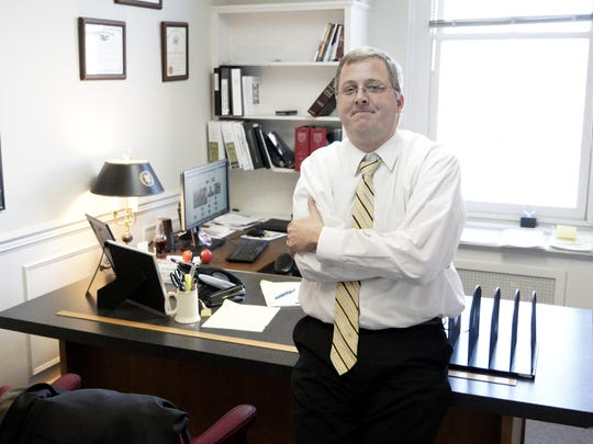 Attorney Tate Love is photographed in his office at Timberlake, Smith, Thomas & Moses, P.C. in Staunton on Tuesday, Jan. 19, 2016. Tate is also a friend of the family of Julian Parrott.