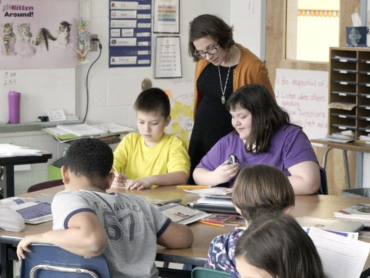 Teacher Nicole Hostetter works with her students during a third grade class at Bessie Weller Elementary in Staunton on Feb. 2, 2016.