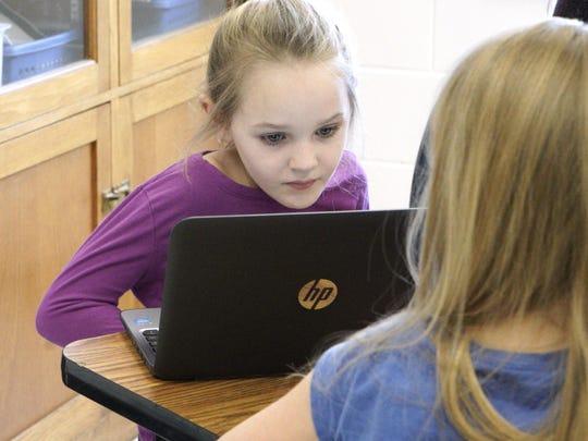 Third-grader Brianna Bishopriggs uses a laptop in class at Bessie Weller Elementary in Staunton on Feb. 2, 2016.