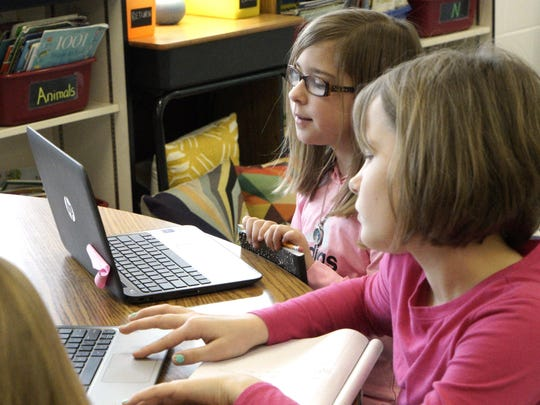 Third-grader Molly Lynch uses a laptop in class at Bessie Weller Elementary in Staunton on Feb. 2, 2016.