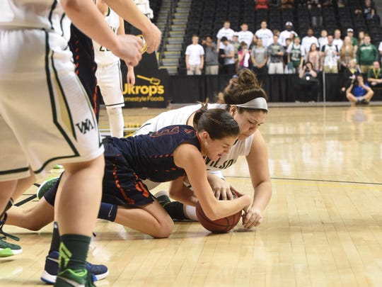 Wilson Memorial's Sarah Sondrol (right) battles Union's Jessica Horner for a loose ball during the Group 2A state semifinals.
