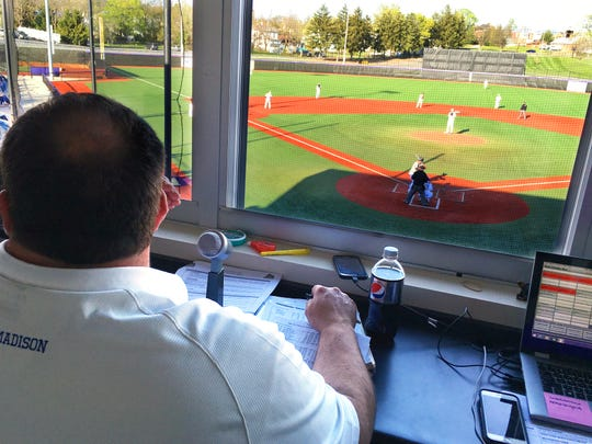 James Hickey, a public address announcer at James Madison, works a baseball game against VMI last week.