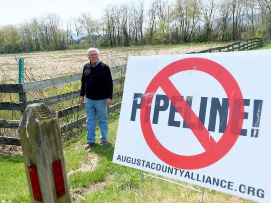 "Scott Ballin is photographed near a ""no pipeline"" sign staked in front of his family's property near Deerfield on Thursday, April 21, 2016. Dominion's alternate route for their proposed Atlantic Coast Pipeline would cross his family's property."