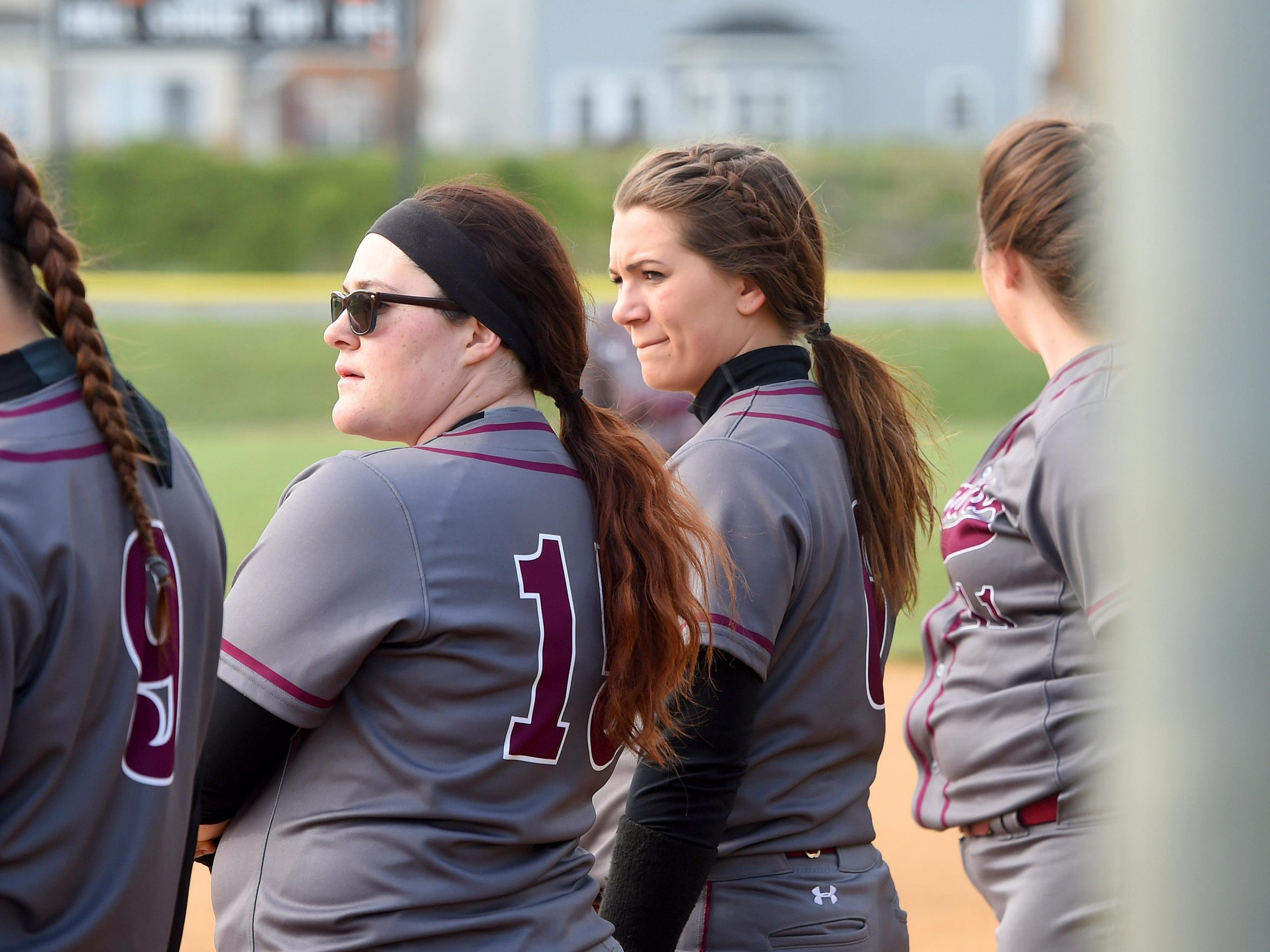 Stuarts Draft's Kayley Campbell stands on the first base baseline with teammates during player introductions at the start of a softball game played in Waynesboro against Waynesboro High School on April 6, 2016.