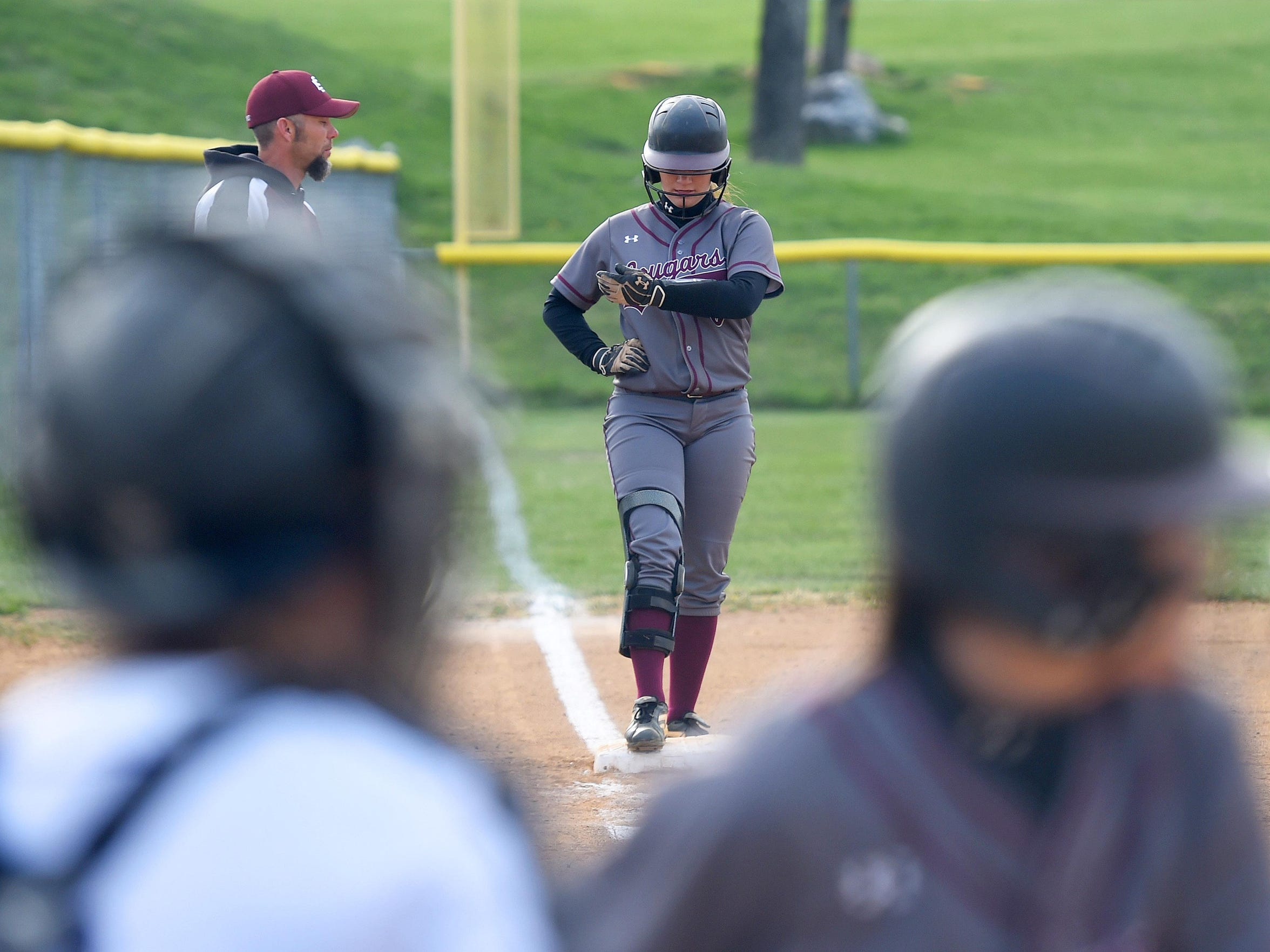Stuarts Draft's Kayley Campbell stands on third base as she waits for the next pitch and the chance to run home during a softball game played in Waynesboro against Waynesboro High School on April 6, 2016.