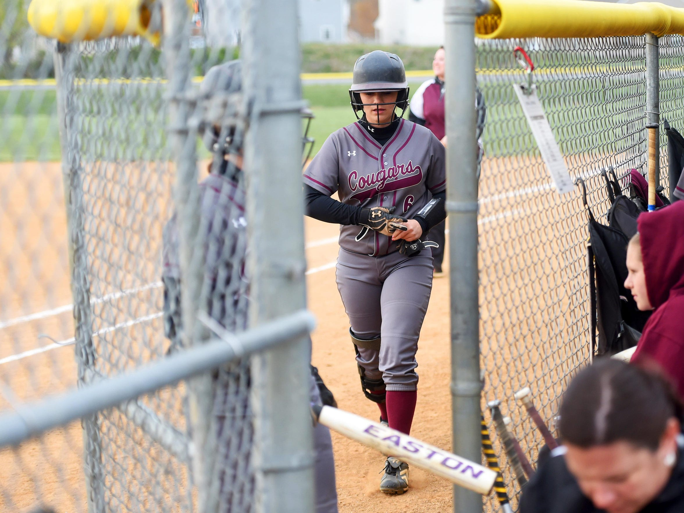 Stuarts Draft's Kayley Campbell pulls off her batter's gloves as she heads to the dugout during a softball game played in Waynesboro on April 6, 2016.