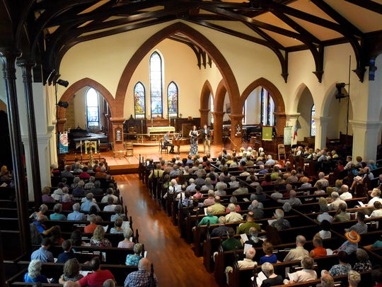The audience watches a Staunton Music Festival free noontime performance at Trinity Episcopal Church on Aug. 17, 2016. Now in its 20th season, planned activities include 30 public concerts in historic venues throughout downtown Staunton from Aug. 11-20.