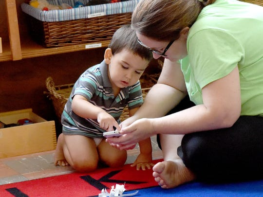 Two-year-old Oliver Virani of Swoope plays with his mother, Ashley Cole-Virani who also listens and participates in a peaceful parenting support group meeting at the Raw Learning Center in Staunton on Aug. 26, 2016.