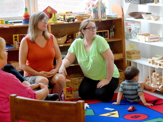 Gleamer Sulivan of Raw Learning Center and parent Ashley Cole-Virani of Swoope listen to other parents speaking during a peaceful parenting support group meeting at the Raw Learning Center in Staunton on Aug. 26, 2016.