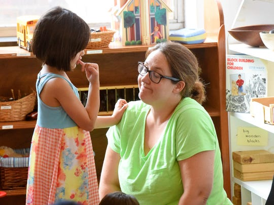 Ashley Cole-Virani of Swoope interacts with her 5-year-old daughter, Zaida Virani, while attending a peaceful parenting support group meeting at the Raw Learning Center in Staunton on Aug. 26, 2016.