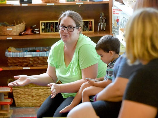 Ashley Cole-Virani of Swoope interacts with other parents during a peaceful parenting support group meeting at the Raw Learning Center in Staunton on Aug. 26, 2016.