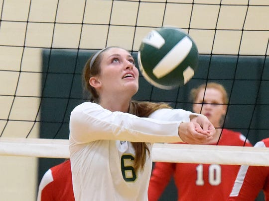 Wilson Memorial's Emma Harrison bumps the ball during a volleyball match played in Fishersville on Thursday, Oct. 20, 2016.