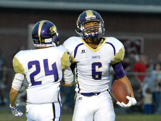 Waynesboro's Jadaciss Williams celebrates a pass completion against the Stuarts Draft defense during the first half of a football game played in Stuarts Draft on Friday, Sept. 12, 2014.