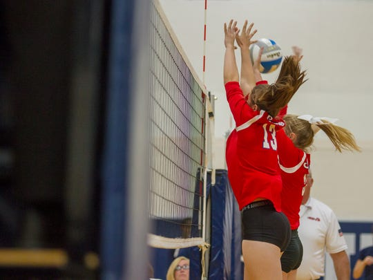 St. Clair's Sam Fraley (13) and Mia Janseen (3) block the ball during their game against Marysville Sept. 7.