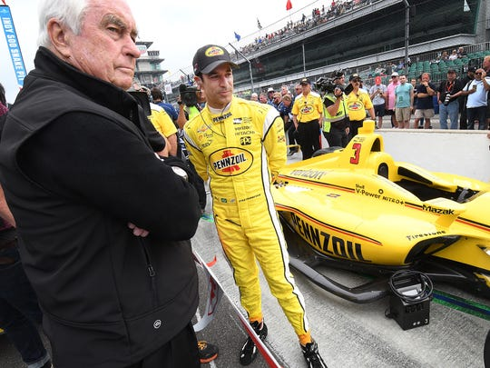 Team Penske IndyCar driver Helio Castroneves (3) with team owner Roger Penske,left, before his run on qualification day for the Indianapolis 500 at the Indianapolis Motor Speedway on Saturday, May 19, 2018.
