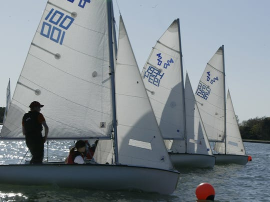 The Grosse Pointe North and the Grosse Pointe South High Schools practice sailboat racing out on Lake St. Clair.