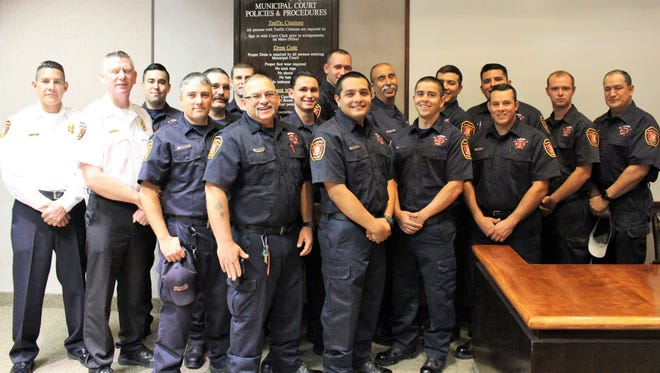 The Alamogordo Fire Department stands together after they each took an Oath of Office to protect residents on Thursday morning.