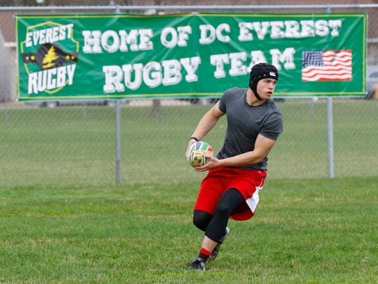A member of the D.C. Everest boys rugby team goes through