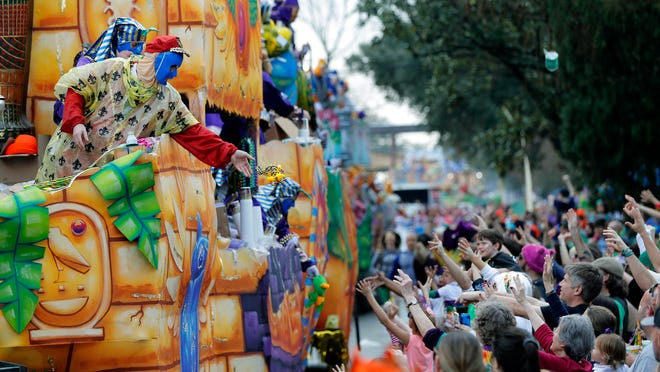 Float riders toss beads and trinkets during the Krewe of Thoth Mardi Gras parade in New Orleans last year. Mayor LaToya Cantrell and her administration laid out plans for this year's festivities on Tuesday.
