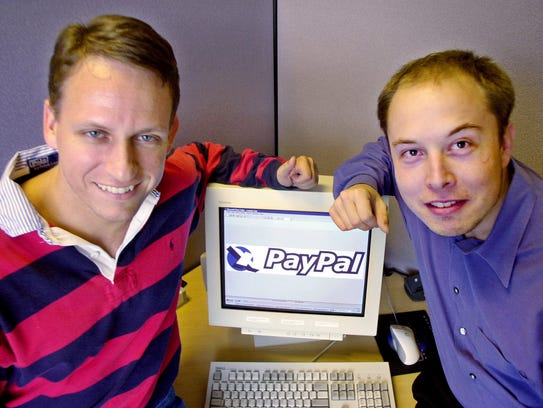 PayPal Chief Executive Officer Peter Thiel, left, and founder Elon Musk, right, pose with the PayPal logo at corporate headquarters in Palo Alto, Calif., on Oct. 20, 2000. Elon Musk made his fortune off PayPal.