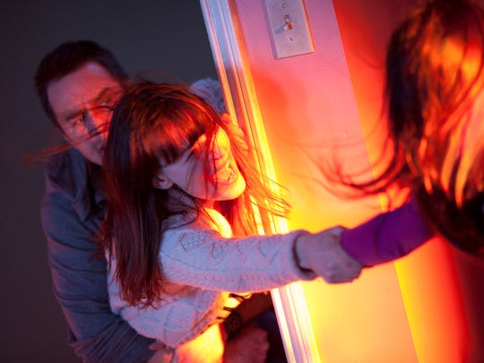 Sam Rockwell, Rosemarie DeWitt and Kennedi Clements are a family haunted by a malevolent spirit in 'Poltergeist.'