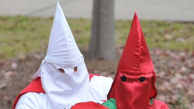 Members of the Ku Klux Klan dress in full robes for a protest on the steps of Fulton Chapel at the University of Mississippi in Oxford, Miss., Nov. 21, 2009.