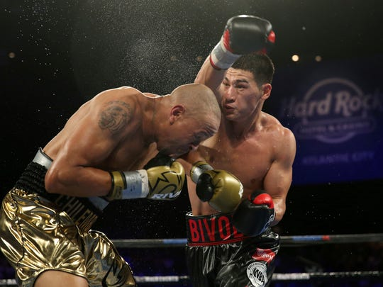 Dmitry Bivol, right, of Russia, swings at Isaac Chilemba, of Malawi, during the sixth round of their light heavyweight bout Saturday, Aug. 4, 2018, in Atlantic City, N.J. (AP Photo/Mel Evans)