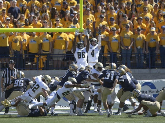 Bryant defenders attempt to block an extra point by Montana State's Gabe Peppenger during the first half on Sept. 10, 2016, in Bozeman.