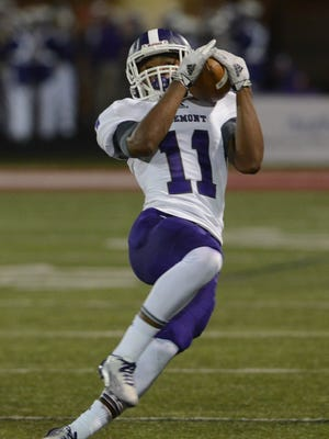 Fremont Ross receiver Jarren Hampton hauls in a pass during the Little Giants' game at Toledo Central Catholic.