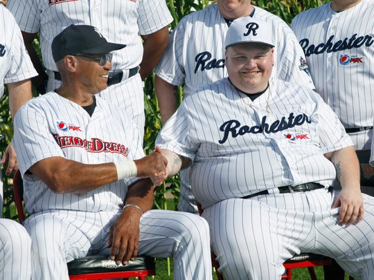 Baseball Hall of Famer Reggie Jackson, left, shakes hands with Johnny Perotti of Rochester in 2013 during a Legends game at Frontier Field sponsored by Pepsi. Rochester is being recognized again by Pepsi as part of a marketing campaign connected to the Super Bowl halftime show.