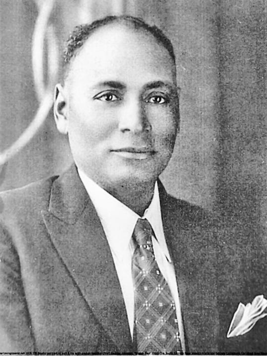 This 1928 photo is a studio portrait of George Johnson in a suit and tie with a pocket handkerchief. He was an ex-slave supposedly won in a poker game by rancher Perry Altman. He was a well-known cowboy who worked for Altman and John Helms and was buried in the Hope Cemetery. No photos of Altman or Helms were found.