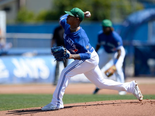 Toronto Blue Jays starting pitcher Marcus Stroman (6) throws a pitch during the first inning of a spring training baseball game against the Canada Junior National Team Saturday, March 17, 2018, in Dunedin, Fla. (AP Photo/Jason Behnken)