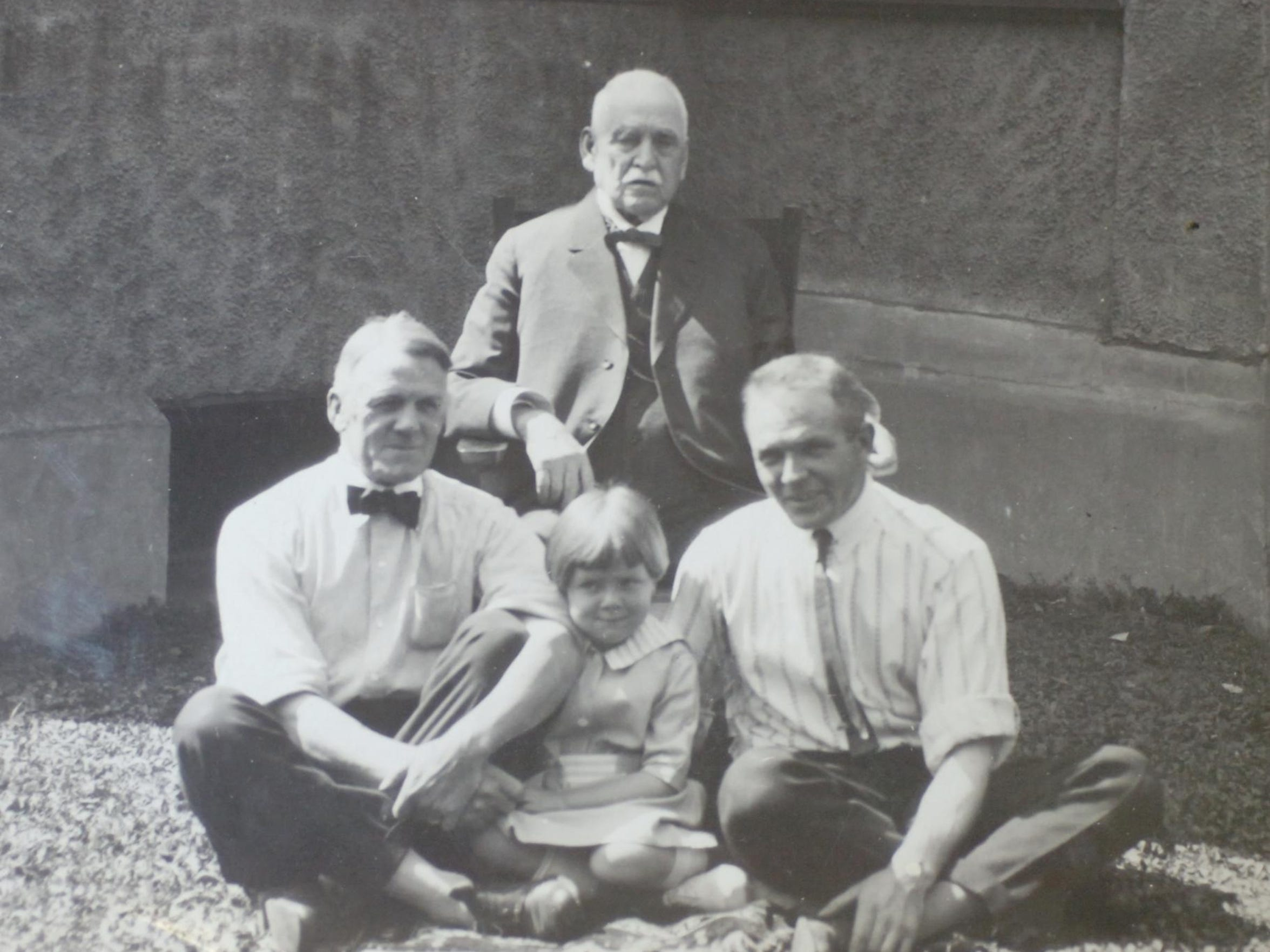 This photograph shows city founder Paris Gibson seated in his favorite chair. In front are his son, Theodore, left, grandson Donald, right, and great-granddaughter Marjorie. Paris and Theo were partners in an oil-drilling venture in Great Falls before World War I.