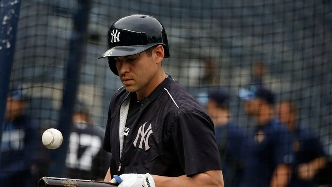 Yankees center fielder Jacoby Ellsbury plays with a ball on his bat during batting practice before a game against the Tampa Bay Rays on Friday, April 22, 2016.