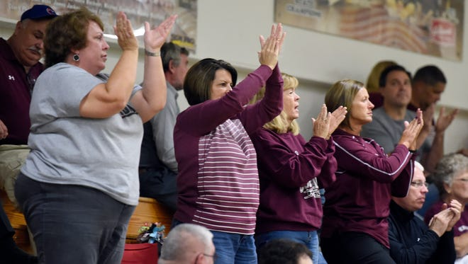 Henderson County fans cheer on the team go up against Christian County during the Second Region volleyball tournament at University Heights Academy in Hopkinsville Tuesday.  Henderson won 3 games to 1 to advance.