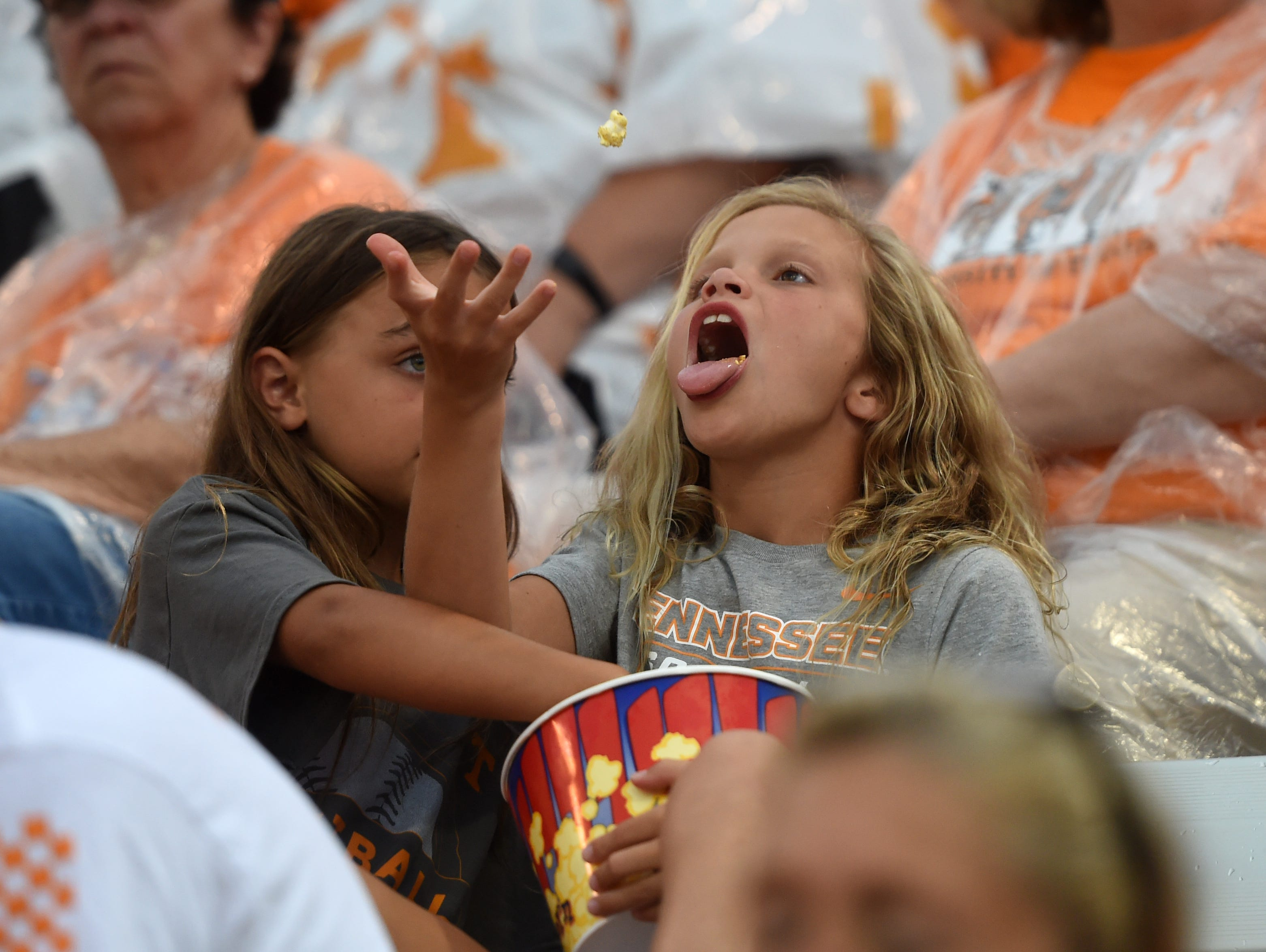 Young Tennessee fans pass time in the stands during an NCAA Super Regional game between Tennessee and Texas A&M at Sherri Parker Lee Stadium on Saturday, May 27, 2017. Texas A&M defeated Tennessee 6-5.