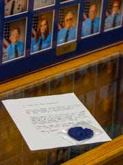 A crocheted heart sits on a letter for Cedar City police