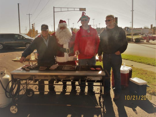 In late October, the Knights of Columbus Council No. 4628, Schofield, joined Santa and volunteers from the Child Life Services of Saint Joseph's Children's Hospital of Marshfield, hosting a brat/hamburger fry. The cookout took place at the Ace Hardware store in Schofield. This event raised money, benefiting the children in the hospital through the Children's Miracle Network. It was a beautiful fall day, and the event was a great success. As pictured, grilling the tasty brats and hamburgers were Knights of Columbus members John Meidl, from left, Santa (Greg Cemke), Nathan Lang and Larry Vesely.