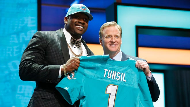 Laremy Tunsil (Ole Miss) with NFL commissioner Roger Goodell after being selected by the Miami Dolphins as the 13th overall pick in the first round of the 2016 NFL Draft at Auditorium Theatre.