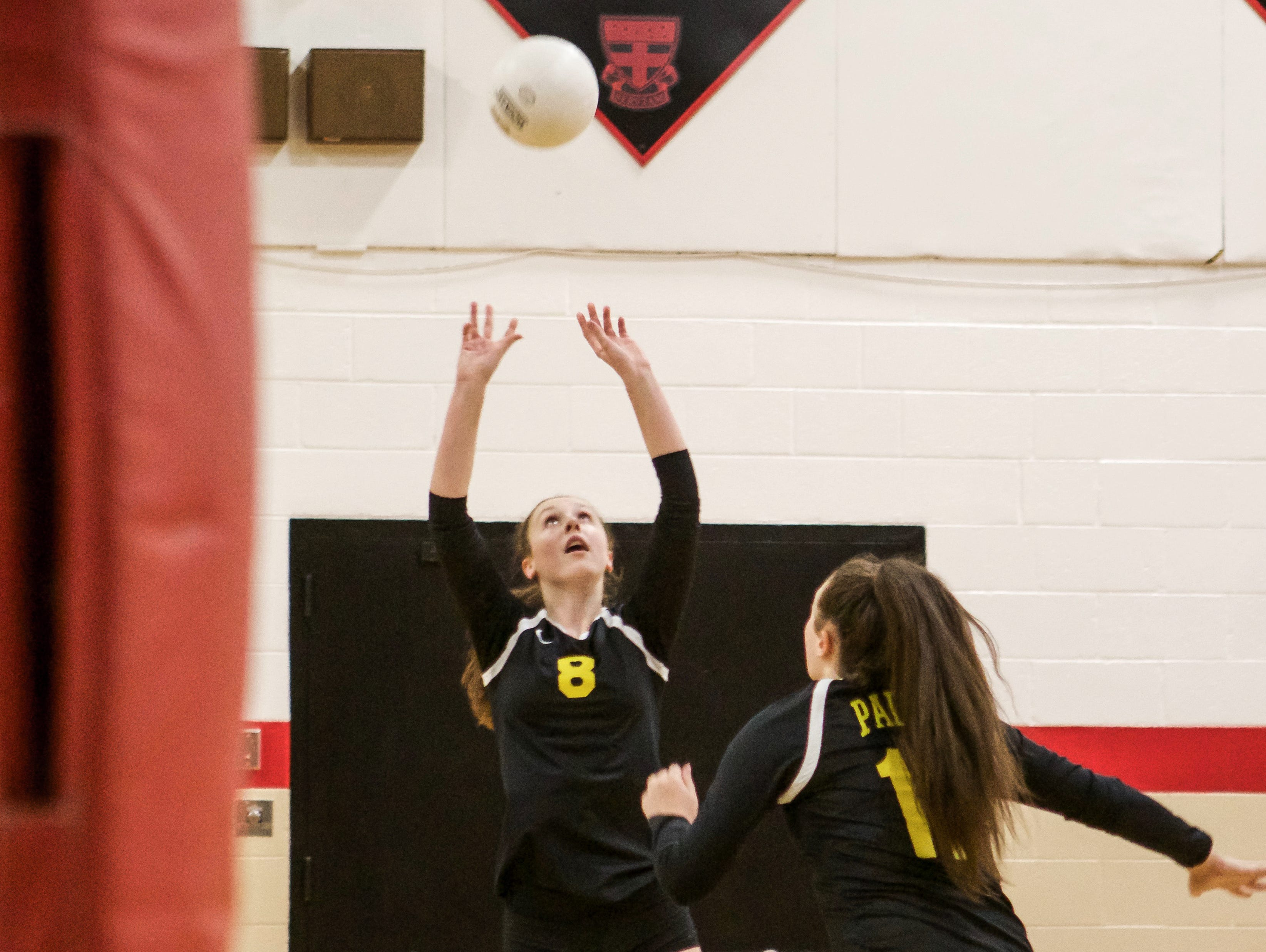 Padua's Emma Lucey (8) sets the ball up for Gabriella Welsh (17) to spike it against Ursuline.