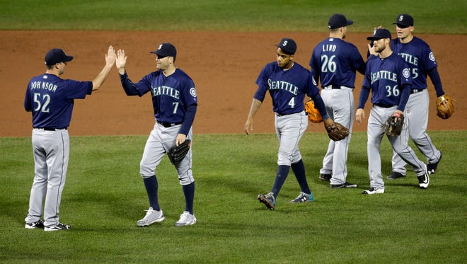 Members of the Seattle Mariners celebrate after a baseball game against the Baltimore Orioles in Baltimore, Tuesday, May 17, 2016. Seattle won 10-0. (AP Photo/Patrick Semansky)