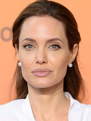 A file picture dated 11 June 2014 shows actress Angelina Jolie arriving at the Global Summit to End Sexual Violence in Conflict, at the Excel Centre in London, Britain. According to media reports on 24 March 2015, Angelina Jolie has had surgery last week to remove her ovaries and fallopian tubes as a prevention measure against cancer.
