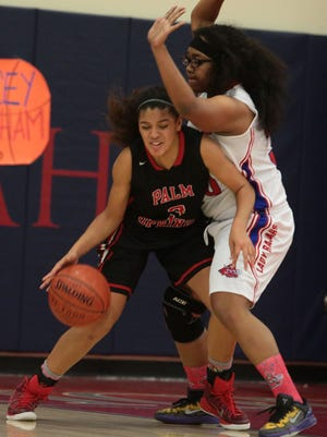 Indio's Jullissa Mendoza pressures Palm Springs' Hannah Wright in girls' basketball Friday. Indio won 30-22 to clinch the Desert Valley League title outright.