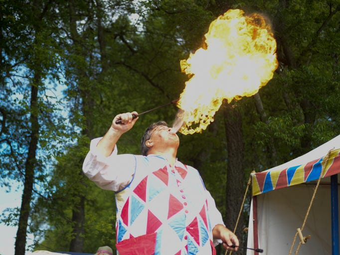 Eric Sites, with the Faire Wynds Players, impresses the crowd with a fiery display during the Bledsoe's Fort Colonial Fair on Saturday May 3.