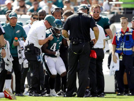 Eagles' running back Darren Sproles is helped up after he was injured during a rushing attempt in the second quarter Sunday.