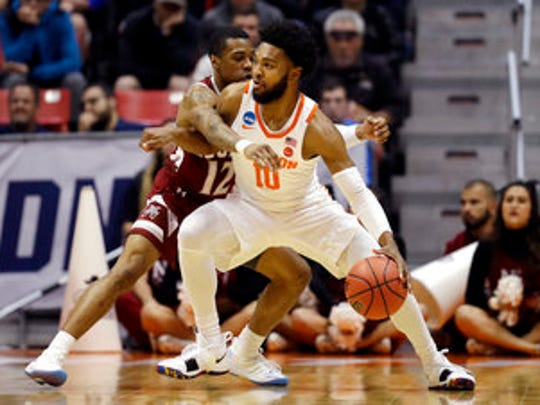 New Mexico State guard A.J. Harris (12) guards Clemson