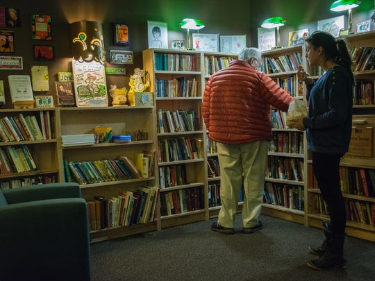 Browsing for books at the UVM Book Nook.
